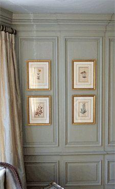 framed artwork in wall panels