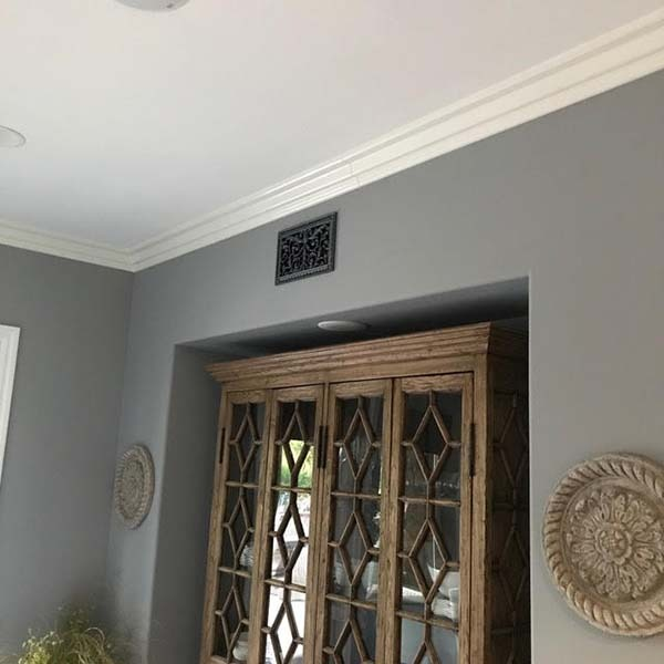 decorative vent cover in Louis XIV style shown in pewter finish