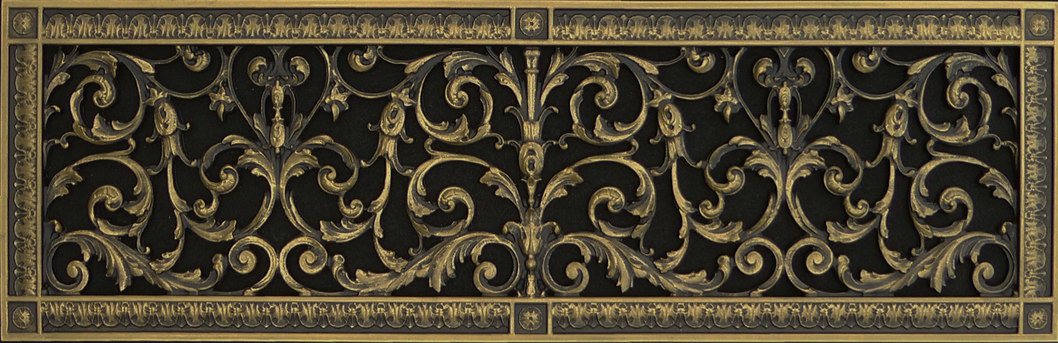 Decorative vent cover 8x30 in Louis XIV style in antique brass finish.